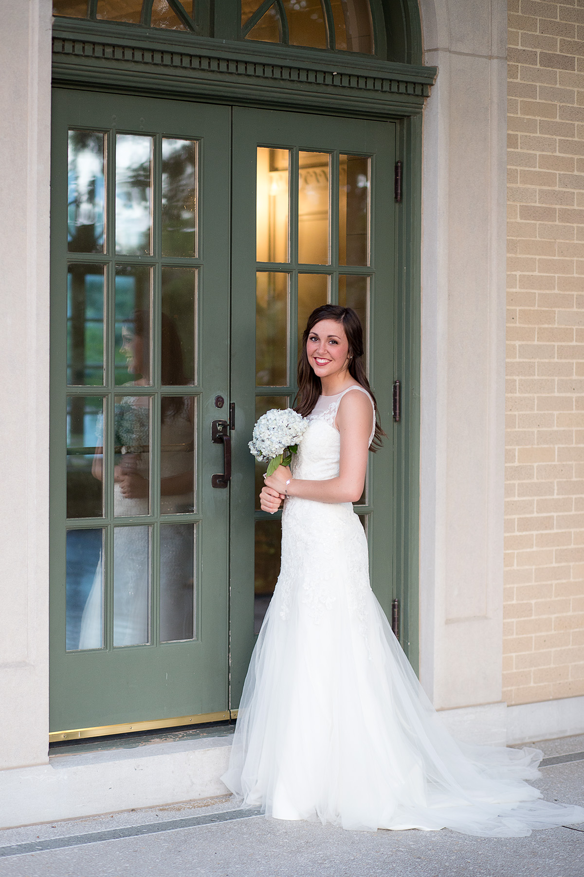 bridal photo with glass door reflection in tulsa oklahoma