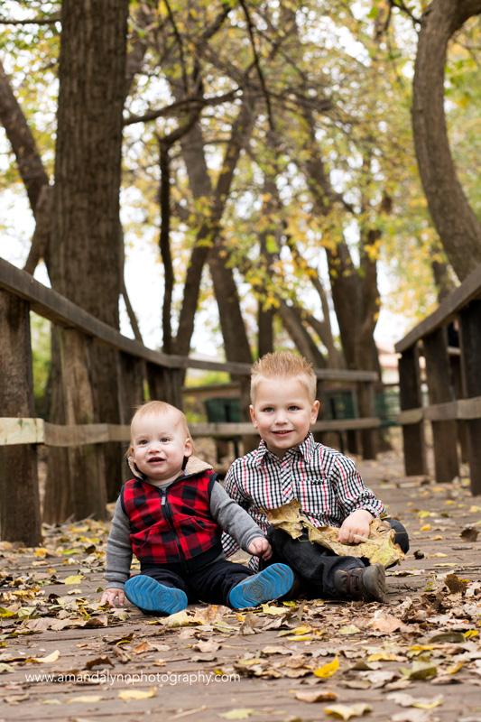 siblings sitting on bridge in midwest city oklahoma