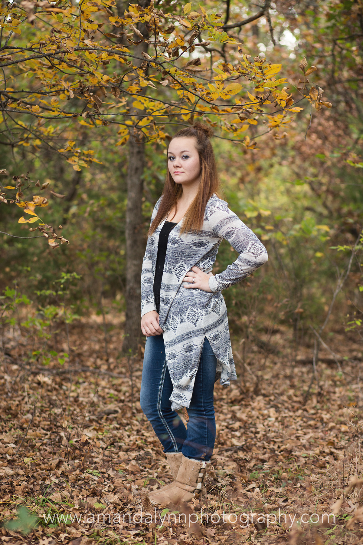 senior girl posing in woods in harrah oklahoma