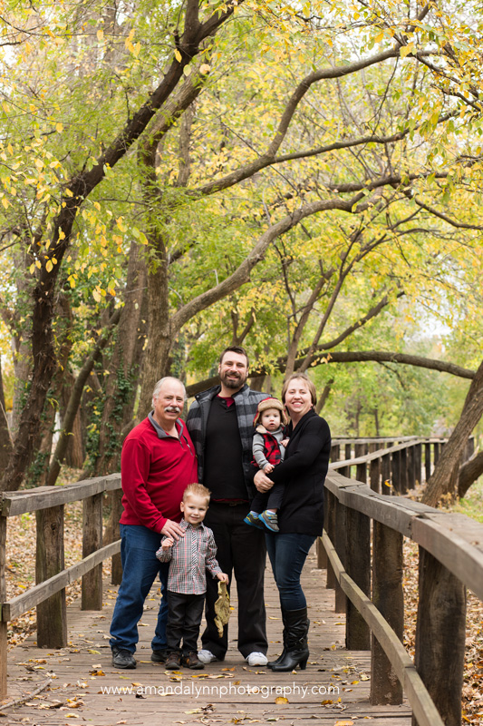 family with grandfather standing on bridge in midwest city oklahoma
