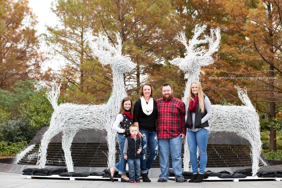 family of five standing in front of reindeer at myriad gardens in oklahoma city