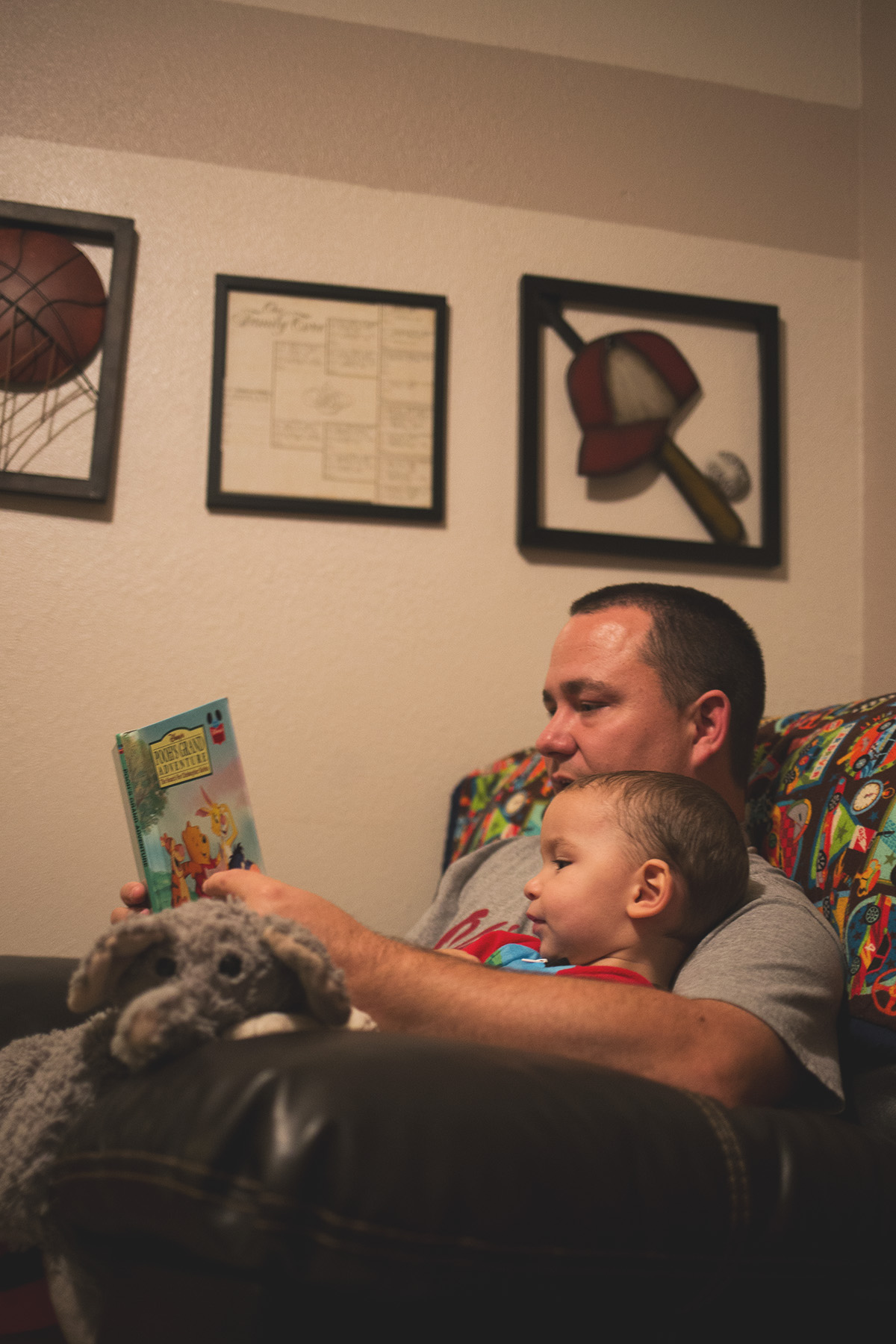 father and son reading winnie the pooh book in harrah oklahoma