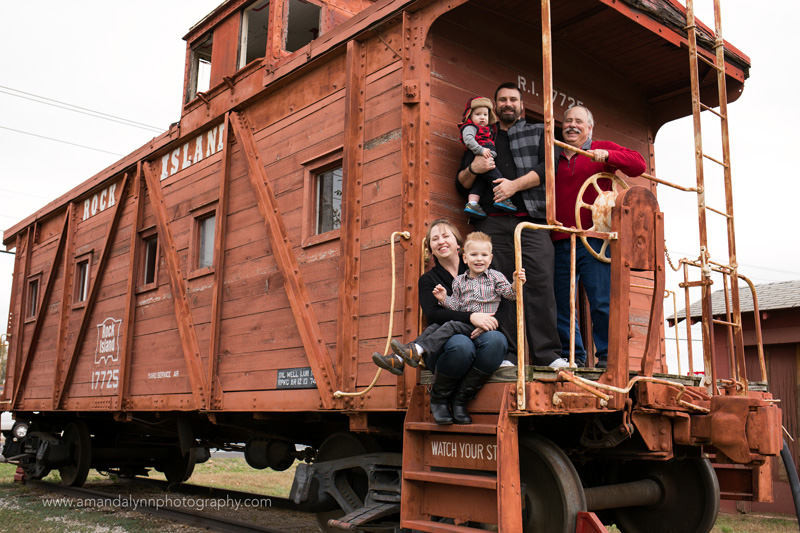 family with grandfather sitting on train in midwest city oklahoma