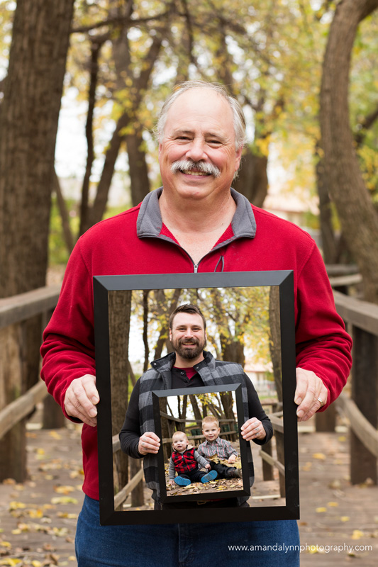 Generations photo with men holding photo frames in midwest city oklahoma