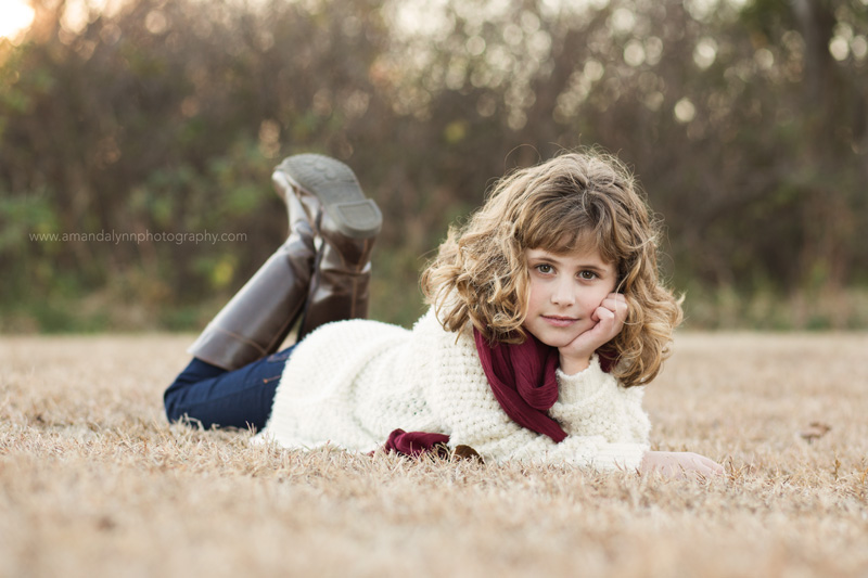 young girl with red scarf posing in norman oklahoma