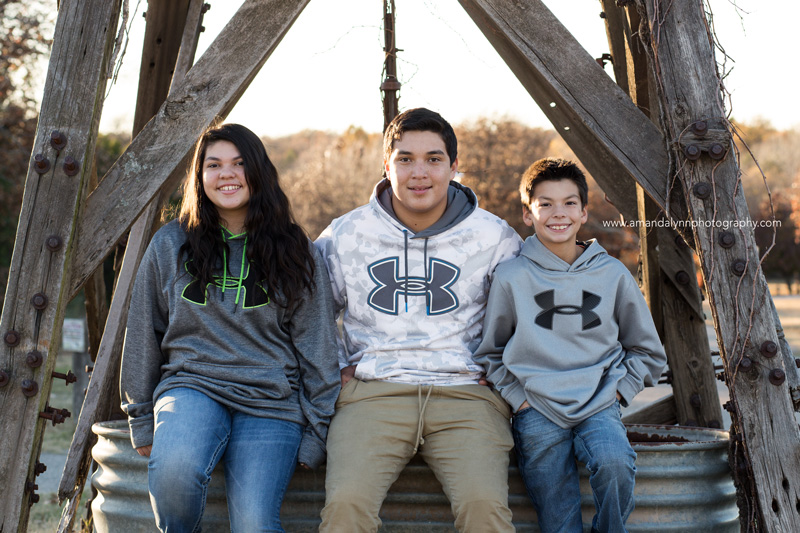 three kids leaning on windmill choctaw oklahoma