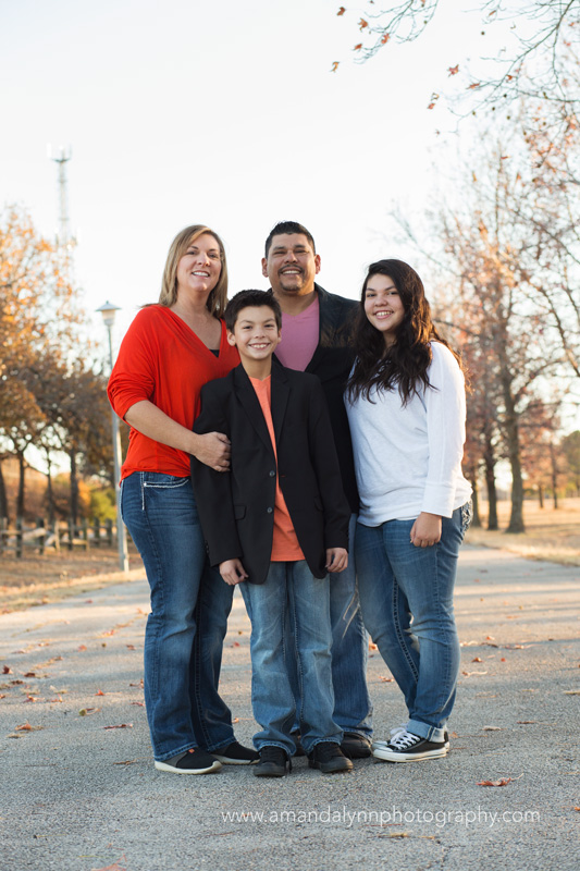 family of four standing in park in choctaw oklahoma
