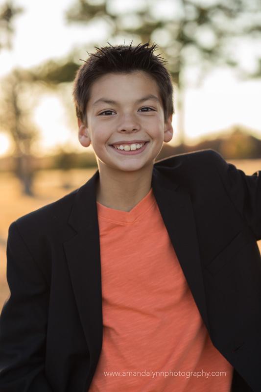 kid wearing black jacket leaning on tree in choctaw oklahoma