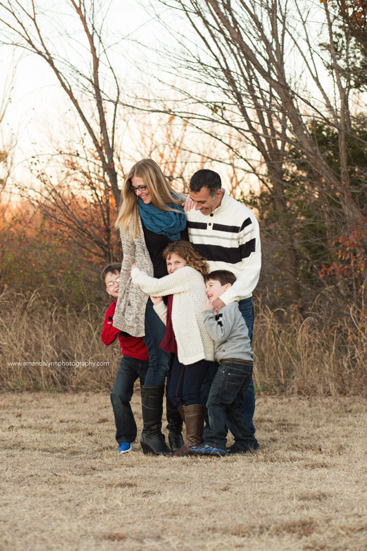 family of five hugging and laughing in norman oklahoma