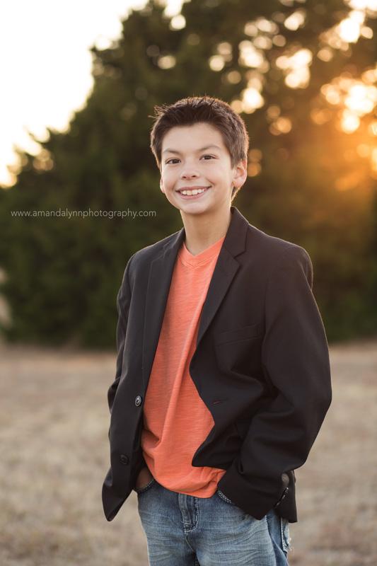kid wearing black jacket posing in park in choctaw oklahoma