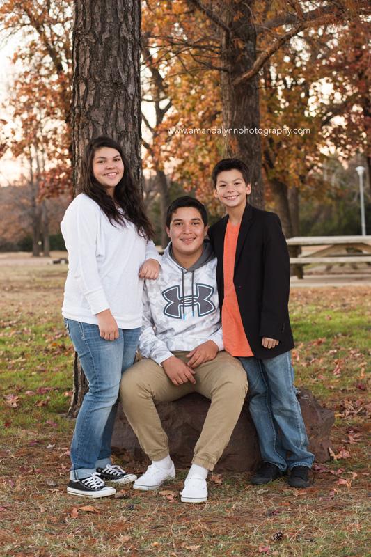 three kids posing in park in choctaw oklahoma