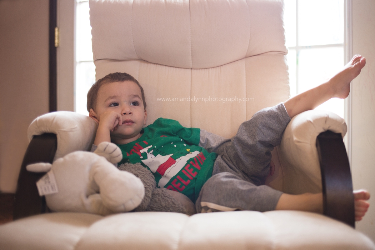 Little boy relaxing with snoopy in chair in harrah oklahoma