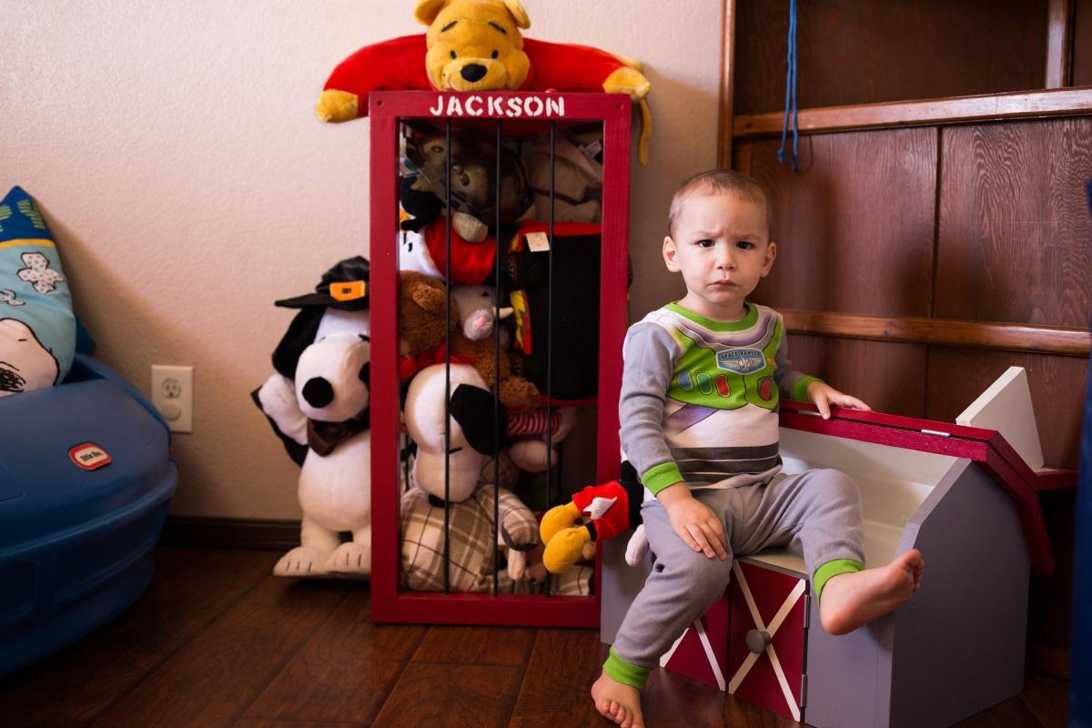 Little boy sitting on toys in harrah oklahoma