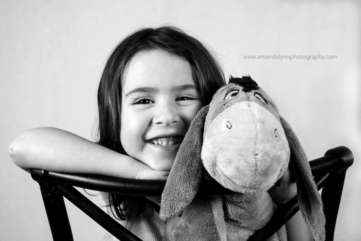 little girl with her best friend, eeyore in harrah oklahoma
