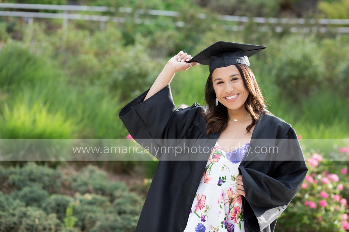 High School Senior Girl wearing a cap and gown at myriad gardens in oklahoma city