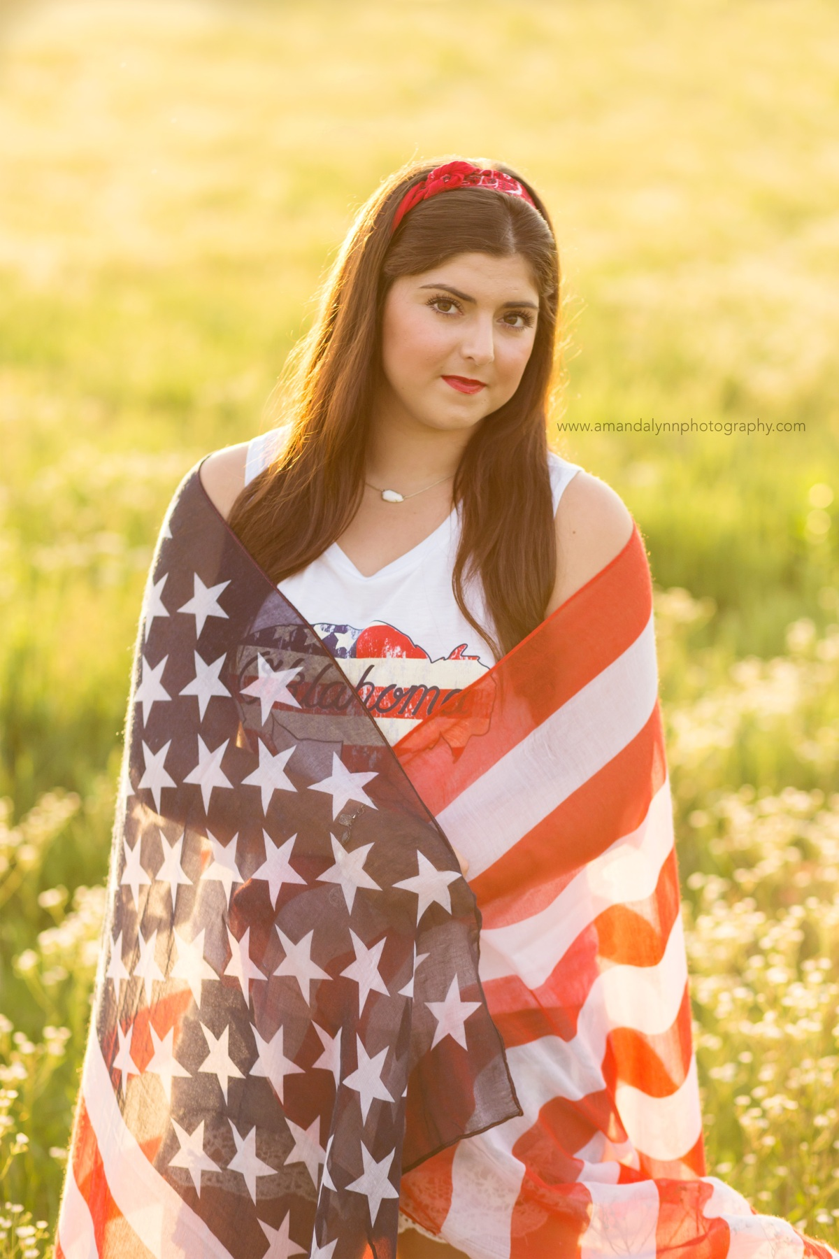 2017 Senior Rep for Amanda Lynn Photography Oklahoma City standing in a field of flowers with american flag