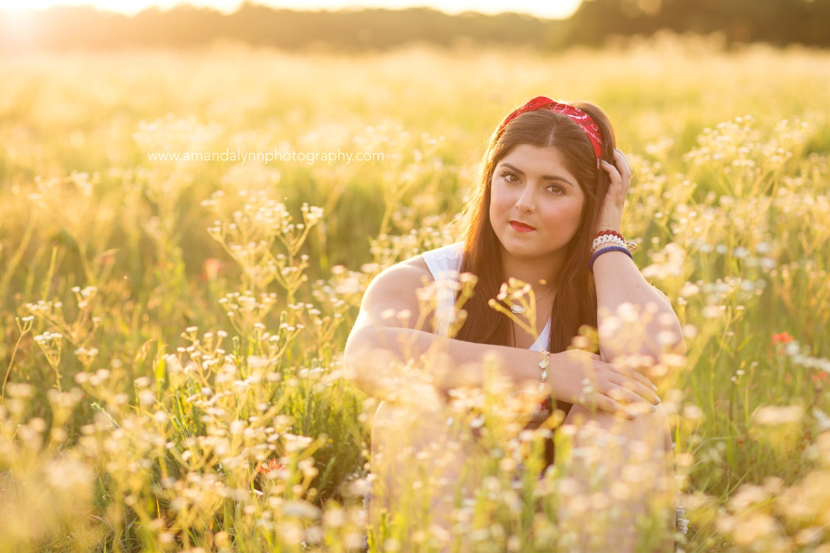 2017 Senior Rep for Amanda Lynn Photography Oklahoma City sitting in a field of flowers