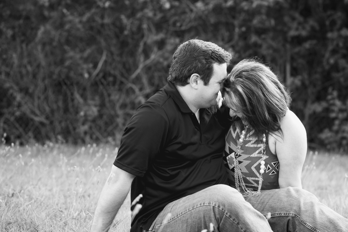 Black and White image of couple posing for an Engagement Session in Harrah Oklahoma July 2016