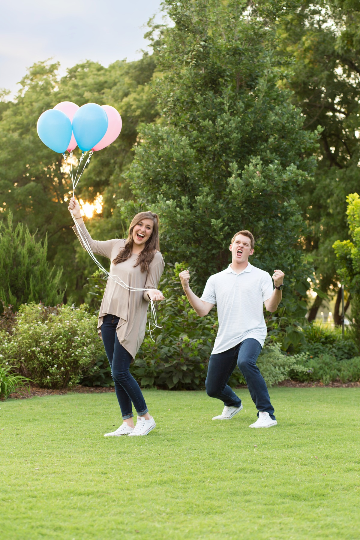 Couple holding balloons at Baby Announcement Photoshoot in Stillwater, Oklahoma July 2016