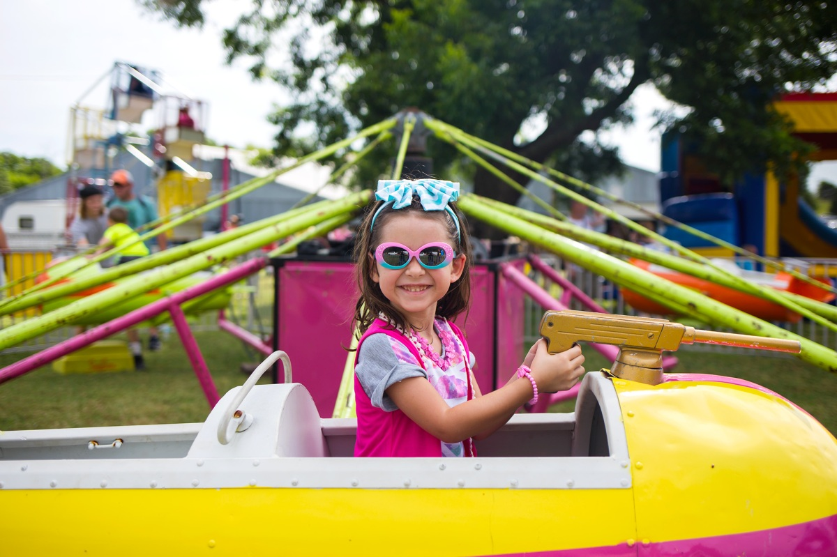 Little girl riding carnival ride at the Stratford Oklahoma Peach Festival 2016 Oklahoma City Photographer