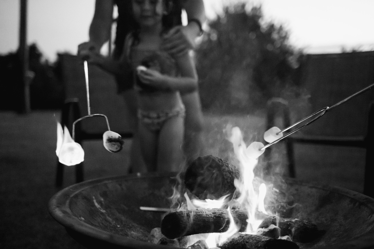 black and white of children roasting marshmallows over fire in harrah oklahoma 2016
