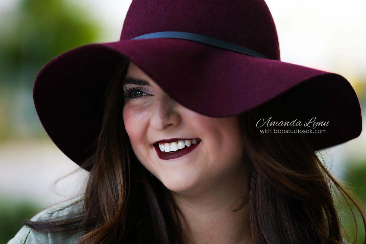 high school senior wearing maroon floppy hat oklahoma city